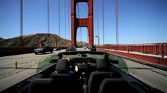 Luxury Convertible Car Driving the Golden Gate Bridge Stock Footage