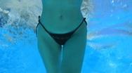 Woman swim in blue pool Stock Footage