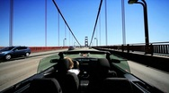 Stock Video Footage of Luxury Convertible Car on the Golden Gate Bridge