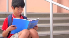 School boy with backpack and book - stock footage