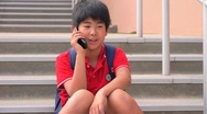 School boy talking on cell phone Stock Footage