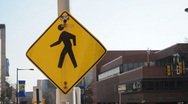 Stock Video Footage of Yield People Walking Sign