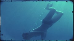 Diving with snorkel (vintage 8 mm amateur film) Stock Footage