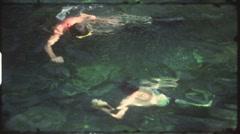Snorkeling in pool (vintage 8 mm amateur film) Stock Footage