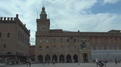 Tourist people relax Piazza Maggiore public square Bologna landmark Italy iconic Stock Footage