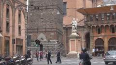 Saint Petronius's Statue traffic street busy downtown Bologna landmark Italy day Stock Footage