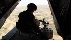 Tail gunner on V-22 Osprey flying over Afghanistan (HD)k Stock Footage