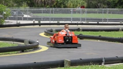 Two Boys Riding Go-Carts #2 Stock Footage