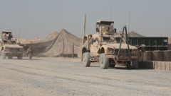 Mine Resistant Ambush Protected vehicles on base in Afghanistan (HD)k - stock footage