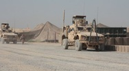 Stock Video Footage of Mine Resistant Ambush Protected vehicles on base in Afghanistan (HD)k