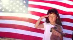 Little Girl with Teddy Bear Saluting with American Flag Stock Footage