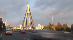 Late afternoon traffic rushes through the ANZAC Bridge in Sydney, Australia Stock Footage