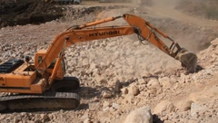 Big excavator operation in stone quarry - stock footage