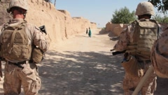 Marines Walking Afghanistan Streets (HD)m Stock Footage