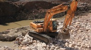 Big excavator operation in stone quarry Stock Footage