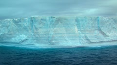 Track past ice face of tabular iceberg Stock Footage