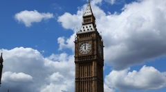 Big Ben strikes twelve o'clock midday in London Stock Footage