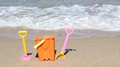 Child's bucket and spade on beach Stock Footage