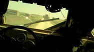 Stock Video Footage of Back View of Military Vehicles Driving Through Afghanistan (HD) C