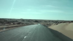 Isolated desert road, Egypt, Black Desert Stock Footage