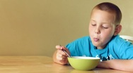 Stock Video Footage of Young Boy eating a bowl of cereal