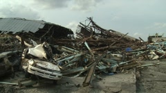 Japan Tsunami Aftermath - Crushed Car And Timber - stock footage