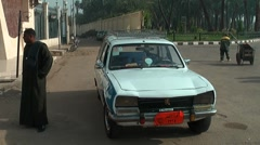 Taxi driver with Peugeot 504, Luxor, Egypt Stock Footage