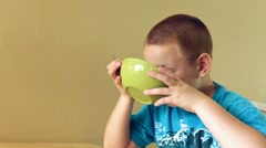Boy drinking Milk from cereal bowl Stock Footage