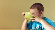 Stock Video Footage of Boy drinking Milk from cereal bowl