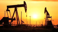 Fossil Fuel Production at Sunset Stock Footage