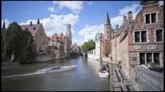 Belgium, Flanders, Bruges, canal, buildings and bell tower, T/Lapse Stock Footage