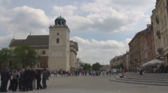 Tourist people relax Castle Square Warsaw Poland cloudy day tourism attraction Stock Footage