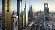 Stock Video Footage of Sheikh Zayed Rd and Metro system at dusk, Dubai, UAE, T/Lapse
