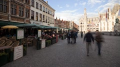 Market Square in Bruges with Restaurants, Pubs and shops, Belgium, T/Lapse Stock Footage