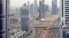 Sheikh Zayed Rd in natural and Illuminated light at an Intersection, Dubai, UAE Stock Footage