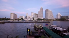Water taxis in natural and Illuminated light Chao Phraya River, Bangkok, T/Lapse Stock Footage