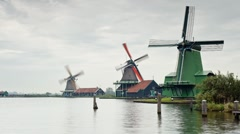 Time Lapse of Windmills along the river banks, Zaanse Schans, Holland Stock Footage