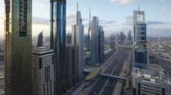 Dubai, Sheikh Zayed Rd, dawn traffic with new high rise buildings, UAE Stock Footage