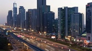 Stock Video Footage of Dubai, Sheikh Zayed Rd, night traffic and Metro Rail, UAE, T/Lapse