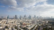 Elevated view over townhouses and Sheikh Zayed Rd, Dubai, UAE - T/lapse Stock Footage