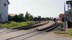 Steam locomotive, railroad, leaving station, Germany Stock Footage