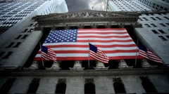 Stock Video Footage of New York Stock Exchange Manhattan NYC American Flag Gloomy Clouds Sky Overhead