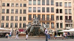 Beautiful fountain in ancient town of Lyon, people walking, France Stock Footage