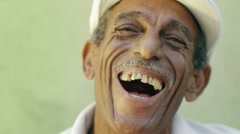 Aged latino man laughing at camera Stock Footage