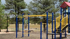 Playing on the Monkey bars Stock Footage