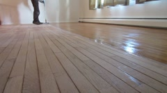 Hardwood floor refinishing - professional coating - stock footage