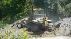Big bulldozer at the building site Stock Footage