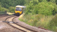 Local passenger train stopping at a rural station in Oxfordshire Stock Footage