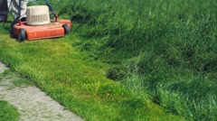 Cutting long grass. Diagonal. Stock Footage