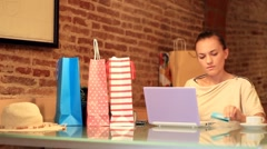Beautiful young woman with laptop and a credit card Stock Footage